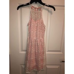 Peach dress with white lace overlay